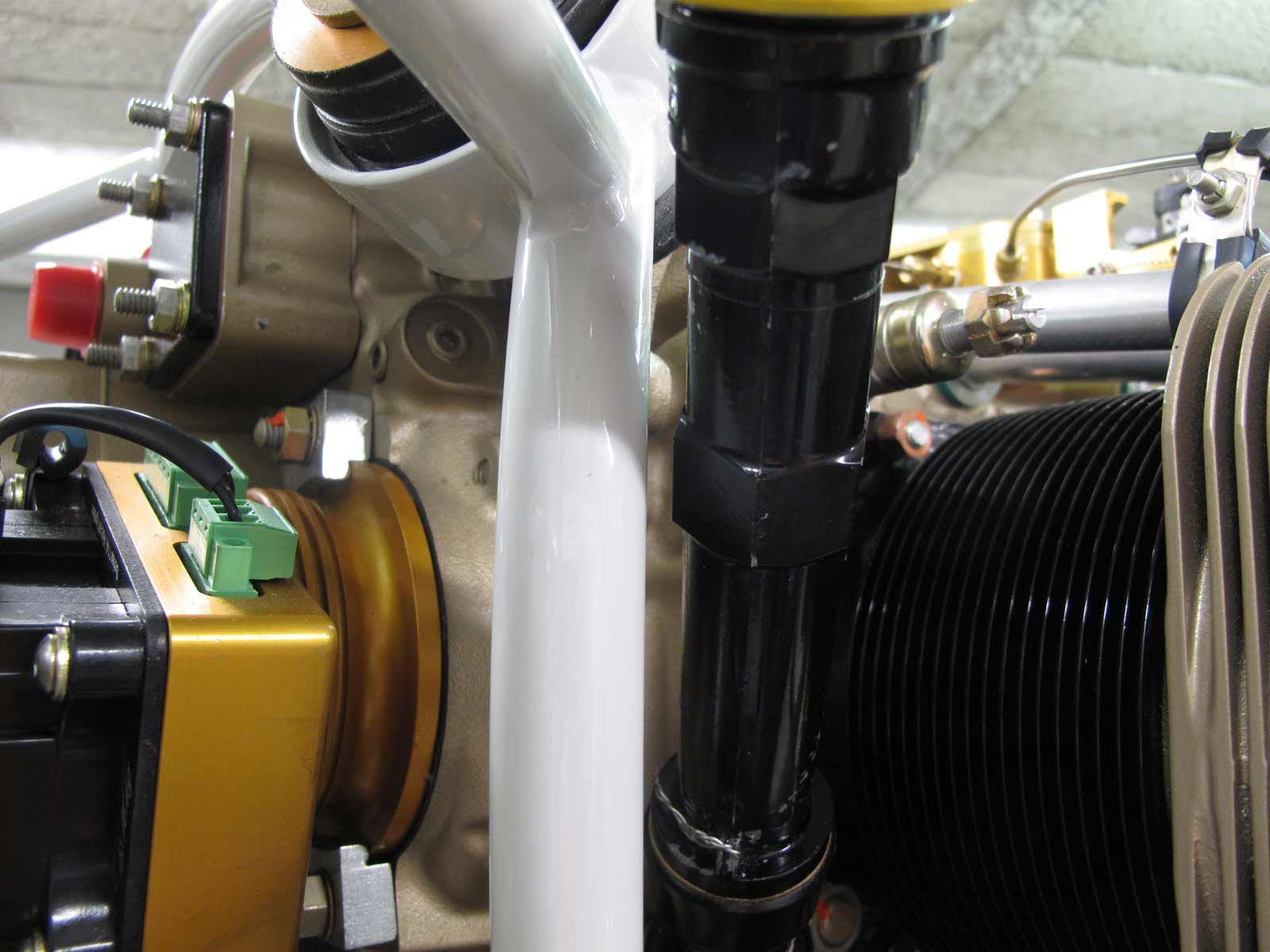 Simplified safety wire due to small extension being closer to the engine block.
